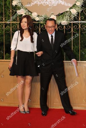 Yang Shoucheng Hong Kong businessman Yang Shoucheng, right, walks on the red carpet at a wedding for Chinese actor Huang Xiaoming and Chinese actress Angelababy in Shanghai, China