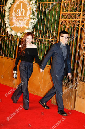 Zhang Liangying Chinese singer Zhang Liangying, left, walks on the red carpet at a wedding for Chinese actor Huang Xiaoming and Chinese actress Angelababy in Shanghai, China
