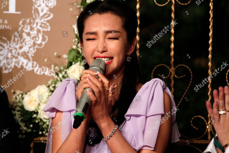 Li Bingbing Chinese actress Li Bingbing poses for photos on the red carpet at a wedding for Chinese actor Huang Xiaoming and Chinese actress Angelababy in Shanghai, China