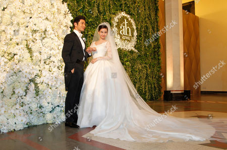 Huang Xiaoming, Angelababy Chinese actor Huang Xiaoming and Chinese actress Angelababy pose for a photo at their wedding in Shanghai, China
