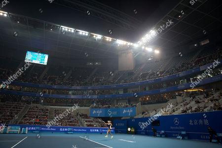Caroline Wozniacki Caroline Wozniacki of Denmark hits a return shot against Bojana Jovanovski of Serbia during their first round match of the China Open tennis tournament at the National Tennis Stadium in Beijing