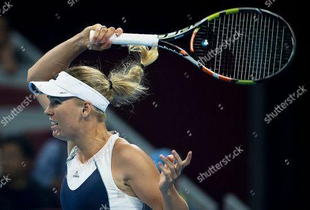 Caroline Wozniacki Caroline Wozniacki of Denmark watches her shot as she plays against Bojana Jovanovski of Serbia during their first round match of the China Open tennis tournament at the National Tennis Stadium in Beijing