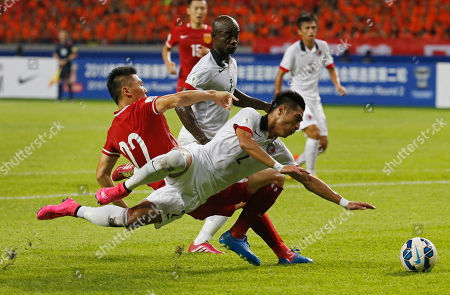 Lee Chi Ho, Yu Dabao Hong Kong's Lee Chi Ho, right, is tackled by China's Yu Dabao, during the 2018 World Cup Asian qualifying match against China in Shenzhen, south China's Guangdong province, . China drew with Hong Kong 0-0