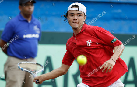 Taro Daniel Taro Daniel of Japan returns the ball against Alejandro Falla of Colombia during the Davis Cup World Group play-offs in Pereira, Colombia, . Taro won the match, 7-6, 6-3, 6-2