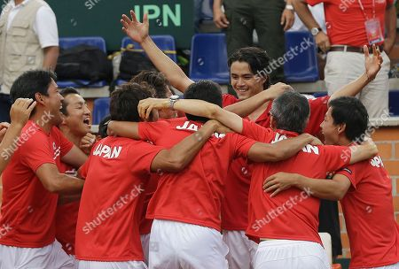 Taro Daniel Taro Daniel, top facing the camera, of Japan celebrates with his teammates after defeating Alejandro Falla of Colombia during the Davis Cup World Group play-offs in Pereira, Colombia, . Taro won 7-6, 6-3, 6-2. Japan won the series 3-2