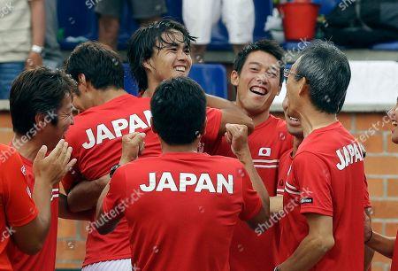 Taro Daniel, Kei Nishikori Taro Daniel, third left, of Japan celebrates with his teammates after defeating Alejandro Falla of Colombia during the Davis Cup World Group play-offs in Pereira, Colombia, . Taro won 7-6, 6-3, 6-2. Japan won the series 3-2