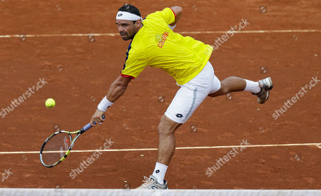 Alejandro Falla Alejandro Falla of Colombia returns the ball to Taro Daniel of Japan, during the Davis Cup World Group play-offs in Pereira, Colombia, . Taro won the match, 7-6, 6-3, 6-2