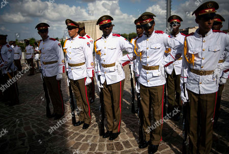 Cuban soldiers wait for the arrival of the President of Laos Choummaly Sayasone for a wreath-laying ceremony at the Jose Marti monument in Havana, Cuba