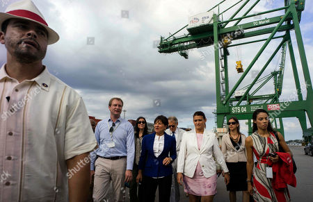 Penny Pritzker, Charles Baker, Ana Teresa Igarza U.S. Commerce Secretary Penny Pritzker, center, walks with the Directors of Mariel Port Charles Baker, second left and Ana Teresa Igarza, third right, during is visits to the container terminal at the port in the Bay of Mariel, Cuba,. Pritzker is in Cuba for a two days official visit