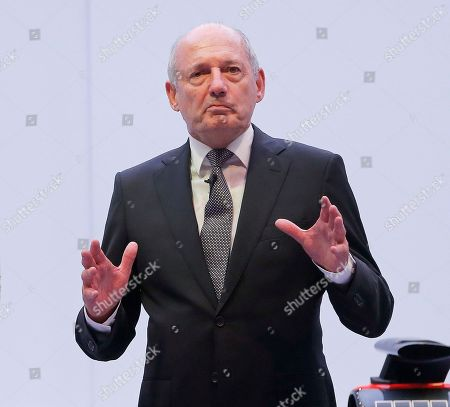 McLaren F1 car brand CEO Ron Dennis gestures during a presentation in Woking, England. McLaren chairman Ron Dennis wants Fernando Alonso to stop airing his grievances in public following the Spanish driver's latest outburst at last weekend's Japanese Grand Prix
