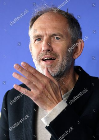 Dutch director Anton Corbjn poses during a photocall for his film Life at the 41st American Film Festival, in Deauville, Normandy, Western France
