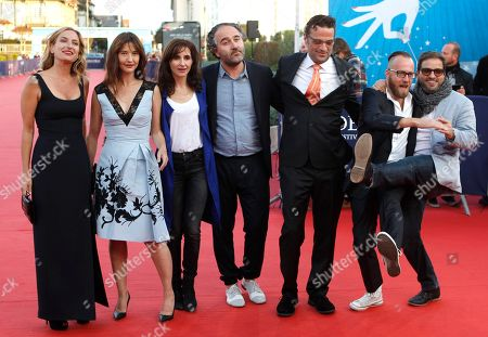 Left to right, US director Zoe Cassavetes, french actress Alexia Landeau, french musician Maud Geffray, french producer Stephane Elfassi, film editor Michael Mees, french DJ Sebastien Chenut, and US actor Russell Steinberg arrive at the 41st American Film Festival, Monday, Sept. 7, 2015, in Deauville, Normandy, Western France