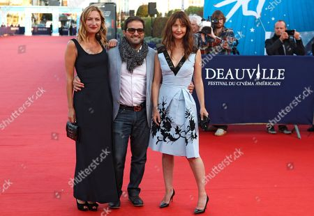 Left to right, US director Zoe Cassavetes, US actor Russell Steinberg and french actress Alexia Landeau,arrive at the 41st American Film Festival, Monday, Sept. 7, 2015, in Deauville, Normandy, Western France