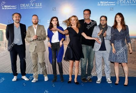 From left, producer Stephane Elfassi, DJ Sebastien Chenut, musician Maud Geffray, director Zoe Cassavetes, editor Michael Mees, actor Russell Steinberg and actress Alexia Landeau pose during a photocall for their film Day Out of Days, at the 41st American Film Festival, in Deauville, Normandy, western France