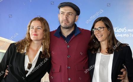 Left to right, French costume designer Valerie Ranchoux, Franco Russian composer Evgueni Galperine and French director Sophie Barthes pose during a photocall for Madame Bovary at the 41st American Film Festival, in Deauville, Normandy, western France