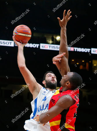 Greece's Yannis Bourousis, left, shoots the ball over Jonathan Tabu during the EuroBasket European Basketball round of sixteen match between Greece against Belgium, at Pierre Mauroy stadium in Lille, France, . Greece won 75-54
