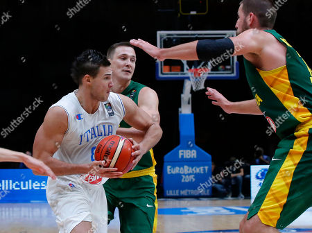 Italy's Danilo Gallinari, left, is blocked by Lithuania's Paulius Jankunas, center, and Jonas Valanciunas, right, during the EuroBasket European Basketball Championship quarterfinal match, between Italy and Lithuania, at Pierre Mauroy stadium in Lille, northern France, . (Lithuania won 95-85