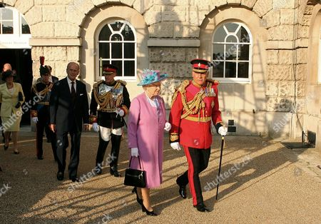 Princess Anne, Prince Philip and Queen Elizabeth II who walks with Lord Guthrie, former Chief of Defence Staff, at Horse Guards Parade as she attends the Household Cavalry Pageant. The Queen officially opened the Household Cavalry Museum before the Pageant. The Pageant involved re-enactments and ceremonial display, featuring 220 horses, 2 mounted bands and 50 armoured vehicles