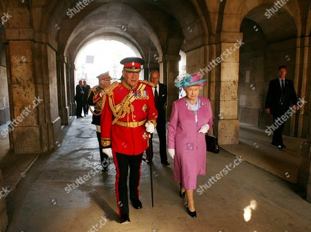 Queen Elizabeth II walks with Lord Guthrie, former Chief of Defence Staff, at Horse Guards Parade as she attends the Household Cavalry Pageant. The Queen officially opened the Household Cavalry Museum before the Pageant. The Pageant involved re-enactments and ceremonial display, featuring 220 horses, 2 mounted bands and 50 armoured vehicles