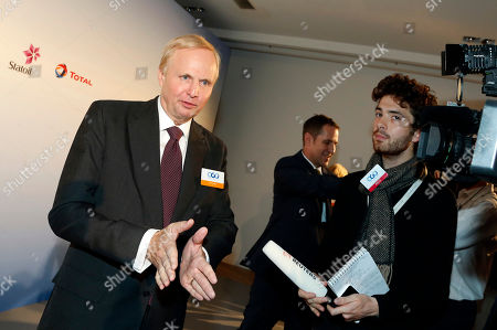 "BP Group Chief Executive Bob Dudley answers reporters after a meeting, in Paris, France. The chief executives of 10 of the world's biggest oil and gas companies have pledged support for an ""effective"" deal to fight global warming at a Paris conference next month"