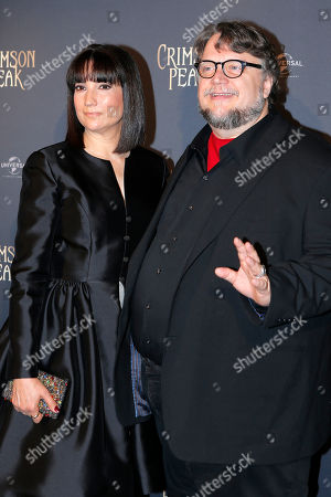 "Director Guillermo del Toro, right, and his wife his wife Lorenza Newton pose during a photocall for ""Crimson Peak"" premiere in Paris"