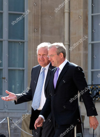 General Electric Co. CEO Jeffrey R. Immelt, left, and Mark Hutchinson, who leads the integration of Alstom SA's energy units, leaves the Elysee Palace after their talks with French President Francois Hollande, in Paris, France. General Electric has won EU approval for its acquisition of Alstom's power business