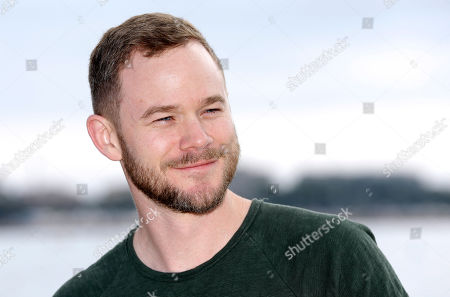 Canadian film and television actor Aaron Ashmore poses during a photocall at the MIPCOM 2015 (International Film and Programme Market for Tv, Video,Cable and Satellite) in Cannes, southeastern France, . He presents the serie ''Killjoys