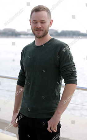 Stock Picture of Canadian film and television actor Aaron Ashmore poses during a photocall at the MIPCOM 2015 (International Film and Programme Market for Tv, Video,Cable and Satellite) in Cannes, southeastern France, . He presents the serie ''Killjoys