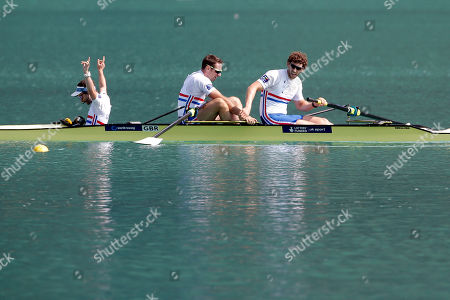 From left, Britain's Henry Fieldman, Nathaniel Reilly-O'Donnell and Matthew Tarrant celebrate after winning the Men's coxed pair during the World rowing championships in Aiguebelette, French Alps