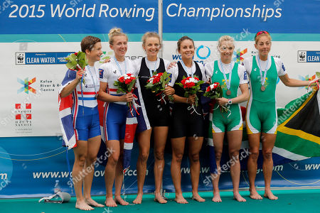 New Zealand's Sophie Mackenzie and Julia Edward, center, celebrate on the podium after winning the Women's lightweight double sculls during the World Rowing Championships, ahead of Great Britain's Charlotte Taylor and Katherine Copeland, left, who finished second, and South Africa's Kirsten Mccann and Ursula Grobler, right, who came third, in Aiguebelette, French Alps