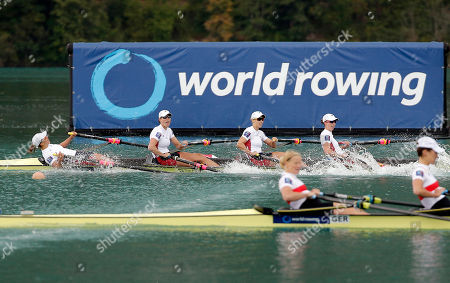 USA's Amanda Elmore, Tracy Eisser, Megan Kalmoe and Olivia Coffey react as they cross the finish line to win the Women's quadruple sculls during the World Rowing Championships in Aiguebelette, French Alps