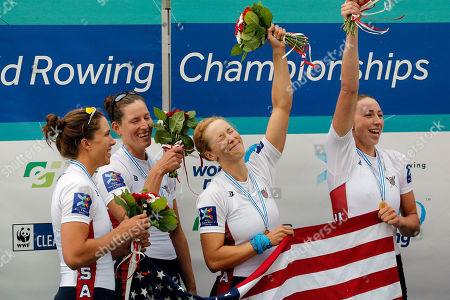 From left, USA's Amanda Elmore, Tracy Eisser, Megan Kalmoe and Olivia Coffey celebrate on the podium after winning the Women's quadruple sculls during the World Rowing Championships in Aiguebelette, French Alps