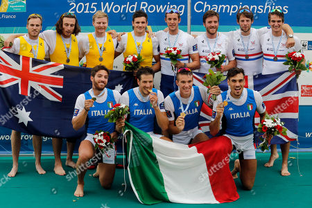 Italy's Marco Di Costanzo, Matteo Castaldo, Matteo Lodo and Giuseppe Vicino, center, celebrate on the podium after winning the Men's four during the World Rowing Championships, ahead of Australia's William Lockwood, Joshua Dunkley-Smith, Spencer Turrin and Alexander Hill, left, who finished second, and Great Britain's Scott Durant, Alan Sinclair, Tom Ransley and Stewart Innes, right, who came third, in Aiguebelette, French Alps