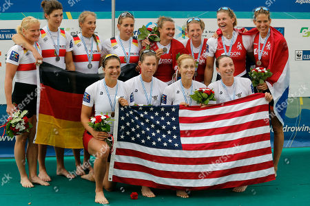 USA's Amanda Elmore, Tracy Eisser, Megan Kalmoe and Olivia Coffey, center, celebrate on the podium after winning the Women's quadruple sculls during the World Rowing Championships, ahead of Germany's Annekatrin Thiele, Carina Baer, Marie-Catherine Arnold and Lisa Schmidla, left, who finished second, and Netherlands' Nicole Beukers, Chantal Achterberg, Inge Janssen and Carline Bouw, right, who came third, in Aiguebelette, French Alps