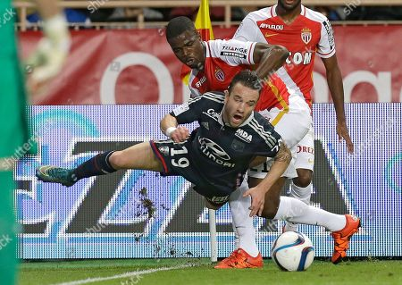 Lyon's Mathieu Valbuena, front, challenges for the ball with Monaco's Elderson Uwa Echiejile during their French League One soccer match, in Monaco stadium