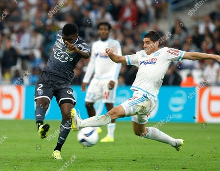 Abdoulaye Diallo, Abdelazziz Barrada Bastia's midfielder Abdoulaye Diallo, left, challenges Marseille's Moroccan midfielder Abdelazziz Barrada for the ball during the League One soccer match between Marseille and Bastia, at the Velodrome Stadium, in Marseille, southern France