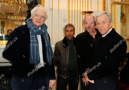 From the left, French film director Bertrand Tavernier, left, French film director of Algerian descent Rachid Bouchareb, French actor Jacques Bonnafe and French-Greek director Coasta Gavras pose before U.S actor Harvey Keitel gets awarded Commander in the of Arts and Letters Order in Paris, France