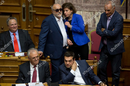 Alexis Tsipras, Yannis Dragasakis Greek Prime Minister Alexis Tsipras, right, and Greece's Deputy Prime Minster Yannis Dragasakis, left, attend a parliamentary session before the confidence vote, in Athens, on