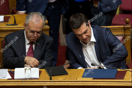 Alexis Tsipras, Yannis Dragasakis Greek Prime Minister Alexis Tsipras, right, and Greece's Deputy Prime Minster Yannis Dragasakis look at their watches during a parliamentary session before the confidence vote, in Athens, on