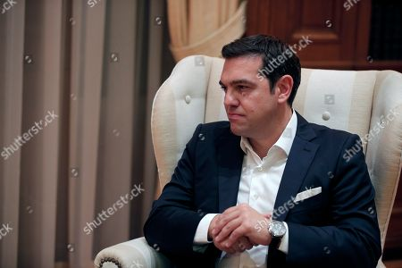 Alexis Tsipras The newly re-elected Prime Minister Alexis Tsipras listens to Greece's caretaker Prime Minister Vassiliki Thanou during a hand out ceremony at Maximos Mansion in Athens, . Syriza's victory Sunday marks a personal triumph for Tsipras, who served as prime minister between January and August - a tumultuous period that saw Greece's future in the 19-country eurozone come under real threat and strict banking controls imposed