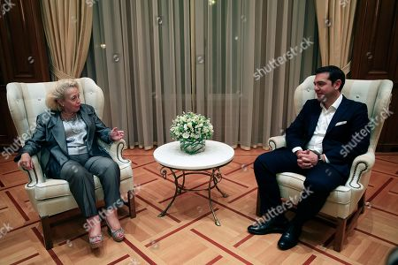 Stock Photo of Vassiliki Thanou, Alexis Tsipras Greece's caretaker Prime Minister Vassiliki Thanou, left, speaks with the newly re-elected Prime Minister Alexis Tsipras during a hand out ceremony at Maximos Mansion in Athens, . Syriza's victory Sunday marks a personal triumph for Tsipras, who served as prime minister between January and August - a tumultuous period that saw Greece's future in the 19-country eurozone come under real threat and strict banking controls imposed