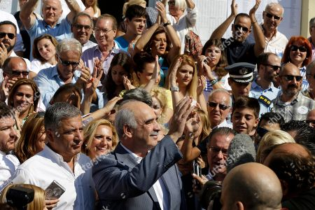 Vangelis Meimarakis Leader of New Democracy main opposition party Vangelis Meimarakis, center, waves to his supporters after casting his vote at a polling station in Athens, . Greeks were voting Sunday in their third national polls this year, called on to choose who they trust to steer the country into its new international bailout