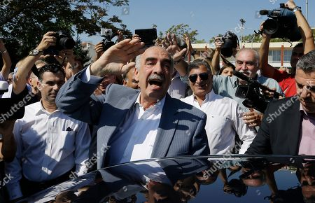 Vangelis Meimarakis Leader of New Democracy main opposition party Vangelis Meimarakis waves to his supporters after casting his vote at a polling station in Athens, . Greeks were voting Sunday in their third national polls this year, called on to choose who they trust to steer the country into its new international bailout