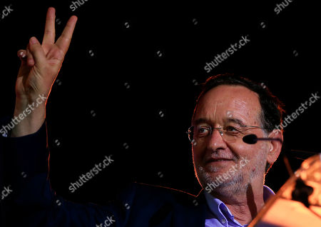 Panagiotis Lafazanis Panagiotis Lafazanis, former energy minister and head of the newly-formed left-wing Popular Unity party, flashes the victory sign during a pre-election rally, in central Athens, . The party broke away from the governing Syriza party ahead of the Sept. 20 general election, hurting its re-election effort. Tsipras called a snap election after reaching an agreement with eurozone countries for a third bailout, and has clung to a slim lead in opinion polls despite a sharp drop in his approval ratings