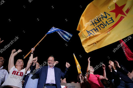 Former energy minister and head of the newly-formed left-wing Popular Unity party Panagiotis Lafazanis, second left, acknowledges the supporters during a pre-election rally, in central Athens, . The party broke away from the governing Syriza party ahead of the Sept. 20 general election, hurting its re-election effort
