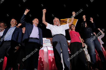 Stock Image of Former energy minister and head of the newly-formed left-wing Popular Unity party Panagiotis Lafazanis, second left, and veteran leftist politician Manolis Glezos, center, and other party candidates acknowledge the supporters during a pre-election rally, in central Athens, . The party broke away from the governing Syriza party ahead of the Sept. 20 general election, hurting its re-election effort