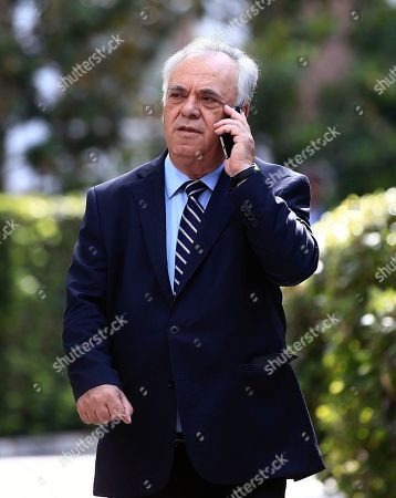 Yannis Dragasakis Greece's Deputy Prime Minster Yannis Dragasakis speaks on his cell phone after a swearing in ceremony of the new cabinet in Athens, . Greece's new leftist-led coalition government has formally assumed its duties, pledging to enforce creditor-demanded spending cuts and reforms while softening the pain on an austerity-weary population