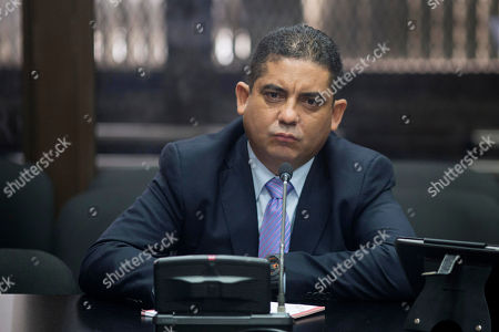 """Juan Carlos Monzon Juan Carlos Monzon Rojas, the personal secretary of former Vice President Roxana Baldetti, appears before a court after he turned himself in to authorities in Guatemala City, . Monzon is accused by authorities of being the head of a corruption ring, known as """"La Linea,"""" in which businesses allegedly paid kickbacks to government officials in exchange for lower import duties, which is believed to have bilked the government of millions of dollars. The corruption scandal has rocked the Guatemalan government and so far has caused the resignation of former President Otto Perez Molina and Baldetti, both jailed and facing charges for allegedly receiving the illegal payments"""