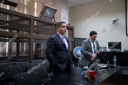 "Stock Photo of Juan Carlos Monzon, Francisco Garcia Gudiel Juan Carlos Monzon, left, the personal secretary of former Vice President Roxana Baldetti, stands during a court hearing after he turned himself into authorities in Guatemala City, . Monzon is accused by authorities of being the head of a corruption ring, known as ""La Linea,"" in which businesses allegedly paid kickbacks to government officials in exchange for lower import duties. It is believed that the scheme bilked the government of millions of dollars. The corruption scandal has rocked the Guatemalan government and so far has caused former President Otto Perez Molina and Baldetti to resign. Both are jailed and are facing charges for allegedly receiving the illegal payments. Prosecutors and an international commission have said Perez Molina and Baldetti were fully aware of the scheme and received half of the kickbacks paid. At right is Monzon's lawyer, Francisco Garcia Gudiel"