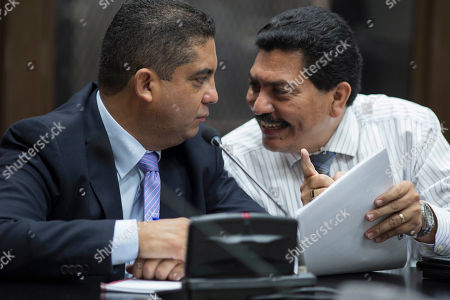 "Stock Image of Juan Carlos Monzon, Francisco Garcia Gudiel Juan Carlos Monzon Rojas, left, the personal secretary of former Vice President Roxana Baldetti, listens to his lawyer Francisco Garcia Gudiel during a court hearing after he turned himself in to authorities in Guatemala City, . Monzon is accused by authorities of being the head of a corruption ring, known as ""La Linea,"" in which businesses allegedly paid kickbacks to government officials in exchange for lower import duties, which is believed to have bilked the government of millions of dollars. The corruption scandal has rocked the Guatemalan government and so far has caused the resignation of former President Otto Perez Molina and Baldetti, both jailed and facing charges for allegedly receiving the illegal payments"